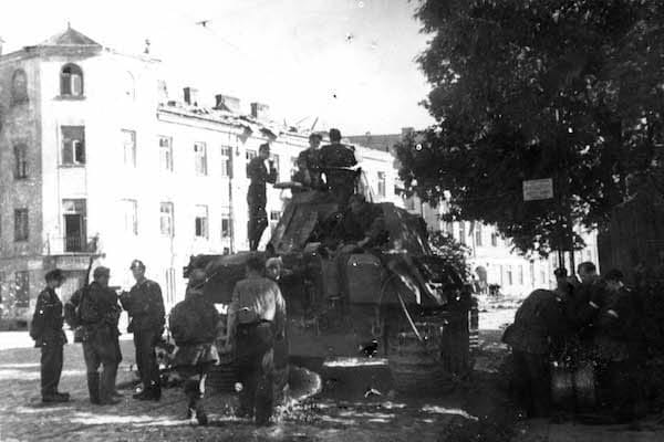 Polish soldiers pose atop their captured tank.